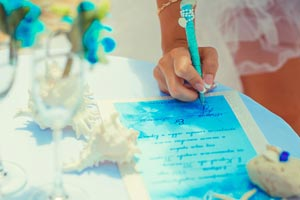 Bride to be signing her official wedding certificate at her Phuket wedding