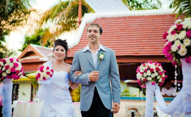 Aree & Phil smiling at their Phuket wedding by Grandforest