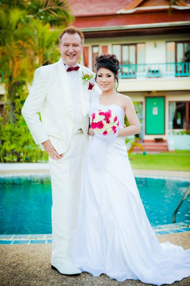 Aree & Phil posing for their wedding photography - Weddings In Phuket