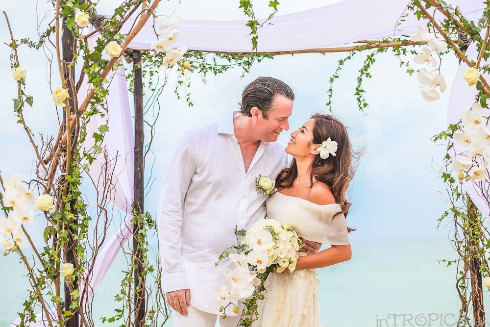 Benjama and Rory's kiss at their Phuket beach wedding - by Weddings In Phuket