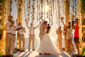 Mary & Igor kissing at their Phuket wedding - by Grandforest Phuket