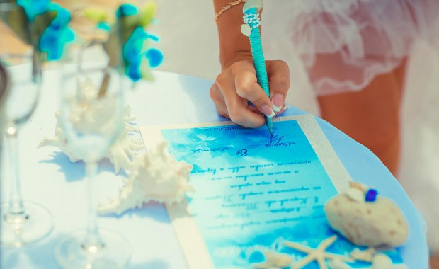Bride to be signing the official wedding certifcate at her Phuket Wedding